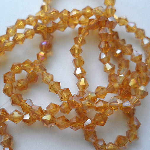 CrystaLine Beads™/bicone 3mm-1ks (topaz AB)