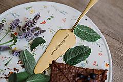 Zlatá lopatka s razeným textom:Láska ide cez žalúdok