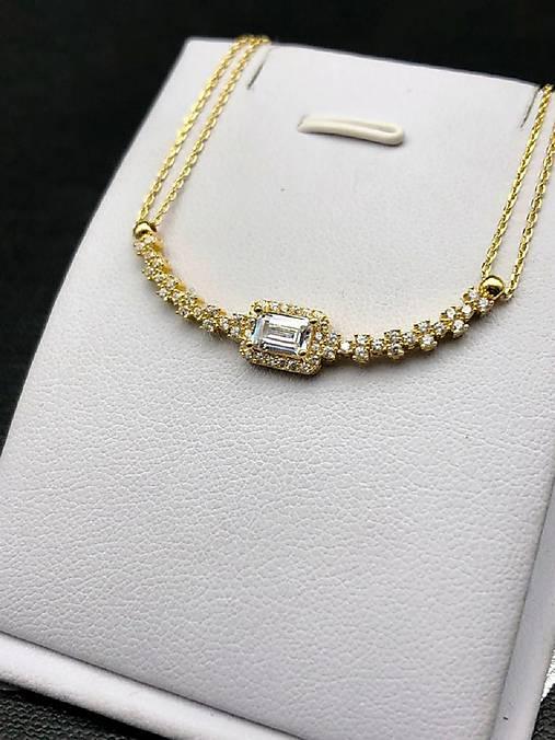 b81588b91 Zlatý náramok so zirkónmi