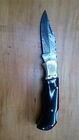 Damaskový vreckový nôž s púzdrom (Rukoväť - byvolý roh - ozdoba)
