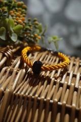 Náramky - Oranžový náramok z točenej šnúry - 11537275_