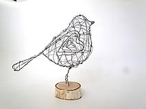 strieborný vtáčik